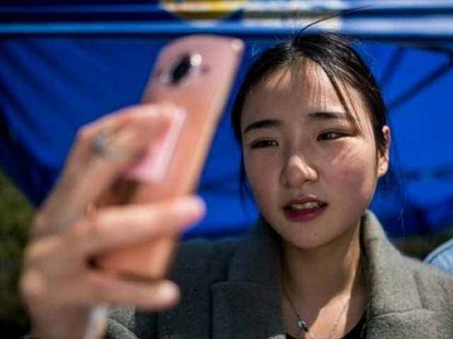 "Jiang Mengna is majoring in ""modelling and etiquette"" at Yiwu Industrial & Commercial College near Shanghai, aspiring to join the growing ranks of young Chinese cashing in on internet stardom.PHOTO: AFP"