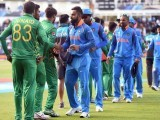 India's captain Virat Kohli (C), leads his teammates as they shakes hands with Pakistan players. PHOTO: AFP