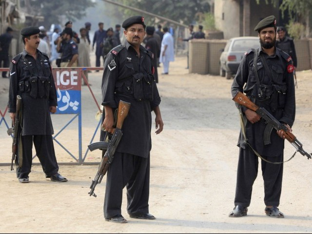 Policemen stand guard in Shahpur village, Peshawar on Saturday, June 24, 2017 where a hideout of suspected terrorists was raided. PHOTO: Reuters