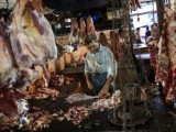 a-butcher-cuts-up-portions-of-beef-for-sale-in-an-abattoir-at-a-wholesale-market-in-mumbai-2-2-2-2