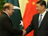 PM Nawaz Sharif shakes hands with Chinese President Xi Jinping. PHOTO: PID
