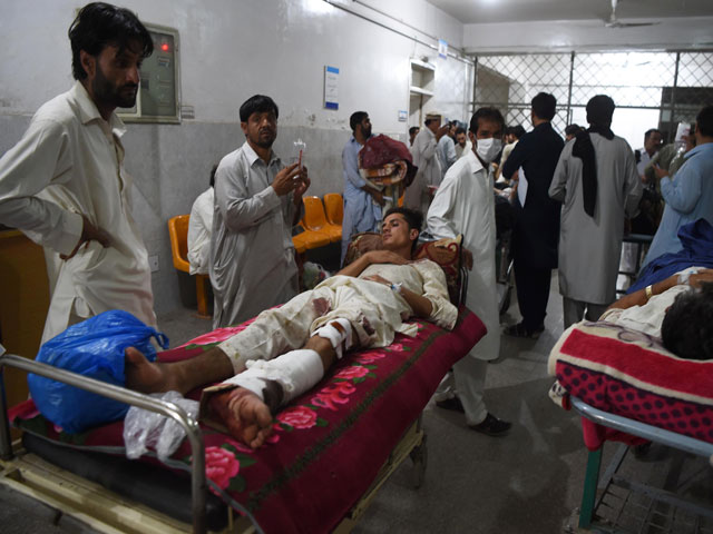 People injured in the twin blasts in Parachinar being treated at a hospital in Peshawar on Friday, June 23, 2017. PHOTO: AFP