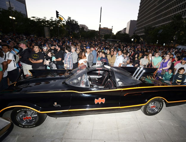 'Quick! To the Batmobile!' -- a favourite line uttered by Adam West in the 1960s TV show. Replicas of the fabled car were at Thursday night's tribute. PHOTO: AFP
