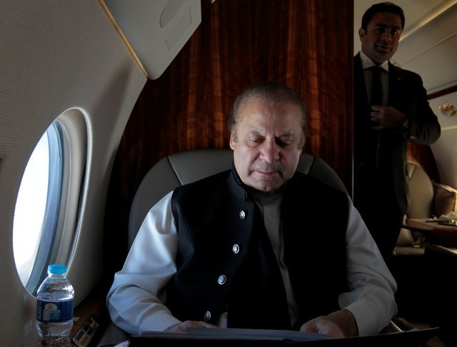 pakistani-prime-minister-nawaz-sharif-works-on-his-official-plane-as-he-travels-to-karachi-to-inaugurate-the-m9-motorway-between-hyderabad-and-karachi-10-2-3