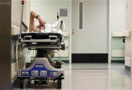 a-patient-waits-in-the-hallway-for-a-room-to-open-up-in-the-emergency-room-at-ben-taub-general-hospital-in-houston-texas-july-27-2009