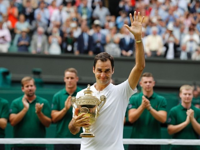 Switzerland's Roger Federer holds the winner's trophy after beating Croatia's Marin Cilic in their men's singles final match, during the presentation on the last day of the 2017 Wimbledon Championships at The All England Lawn Tennis Club in Wimbledon, southwest London, on July 16, 2017. Roger Federer won 6-3, 6-1, 6-4. PHOTO: AFP