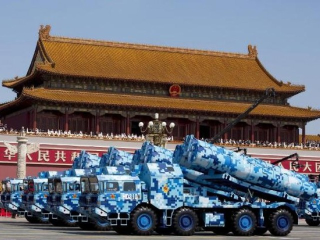 Military vehicles carry cruise missiles during a military parade to commemorate the end of World War II in Beijing. Reuters