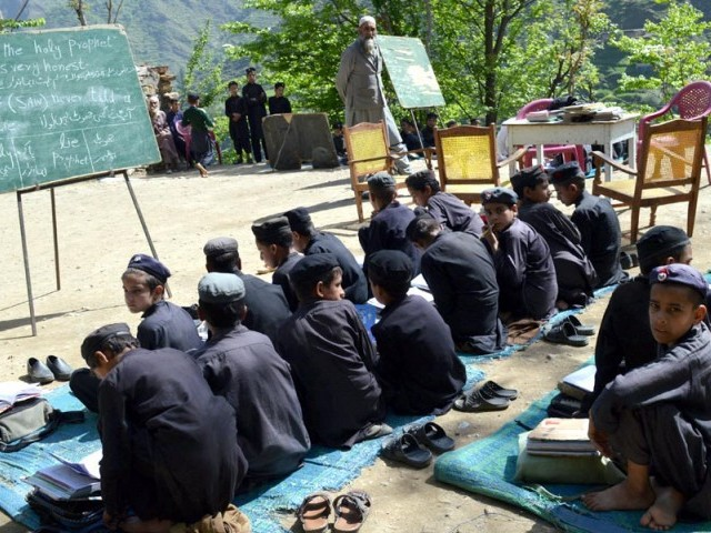 A government school in Shangla in an undated picture. According to the latest IMU report, 24% of schools in Shangla do not have a boundary wall. PHOTO: INP