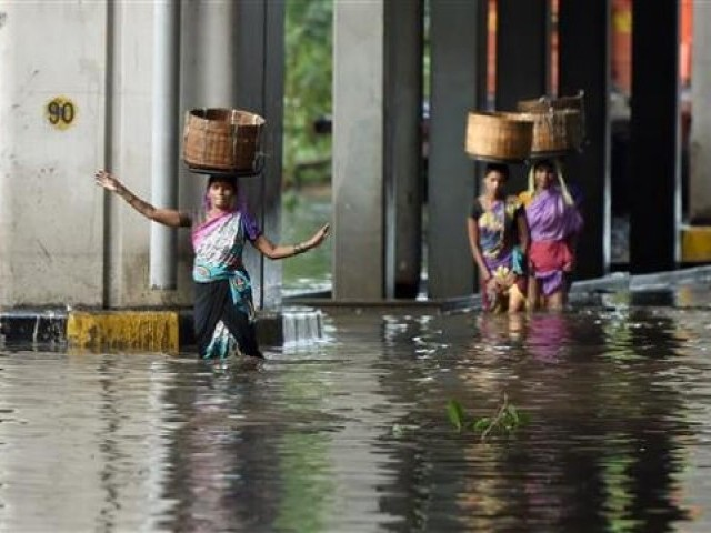 Flooding has risen to at least 76, officials said Monday, with eight people killed in the past day. PHOTO: AFP