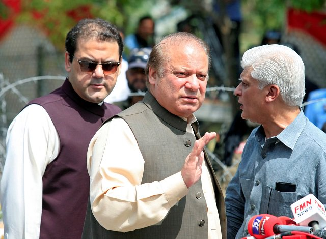 Prime Minister Nawaz Sharif waves as his son, Hussain Nawaz looks on. PHOTO: REUTERS / FILE