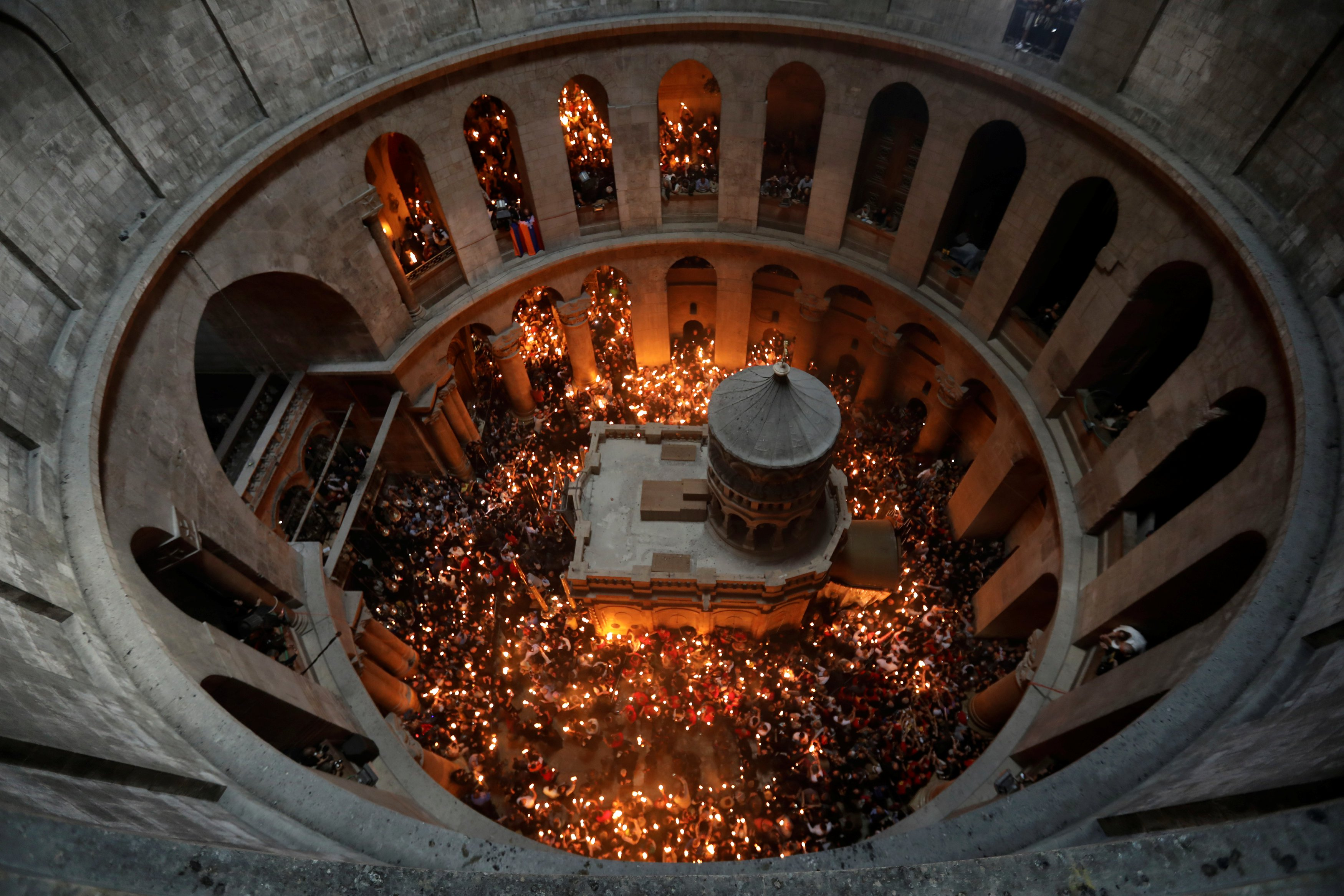 Worshippers hold candles as they take part in the Christian Orthodox Holy Fire ceremony at the Church of the Holy Sepulchre in Jerusalem's Old City PHOTO: REUTERS