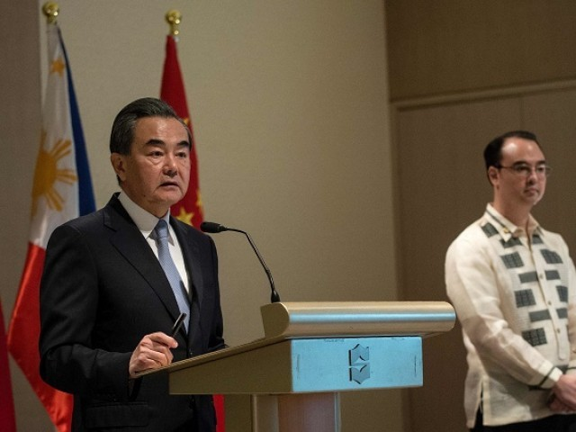"China's Foreign Minister Wang Yi (L) and Philippine Foreign Affairs secretary Alan Peter Cayetano (R) attend a joint press conference in Manila on July 25, 2017.  China urged Southeast Asian nations on July 25 to unite and ""say no"" to outside forces seeking to interfere in the South China Sea dispute - an apparent swipe at the United States ahead of a regional summit. China's Foreign Minister Wang Yi made the statement during a two-day visit to Manila where he hailed the ""strong momentum"" in the improvement of bilateral ties under Philippine President Rodrigo Duterte. PHOTO: AFP."