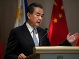 "China's Foreign Minister Wang Yi gestures during a joint press conference with Philippine Foreign Affairs secretary Alan Peter Cayetano in Manila on July 25, 2017.  China urged Southeast Asian nations on July 25 to unite and ""say no"" to outside forces seeking to interfere in the South China Sea dispute - an apparent swipe at the United States ahead of a regional summit. China's Foreign Minister Wang Yi made the statement during a two-day visit to Manila where he hailed the ""strong momentum"" in the improvement of bilateral ties under Philippine President Rodrigo Duterte. PHOTO: AFP"