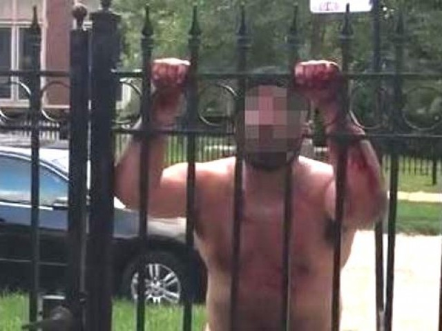 The footage begins by showing the man, who is bleeding heavily from his crotch, shouting nonsense and swearing at residents who are behind a large metal gate. PHOTO COURTESY: MailOnline