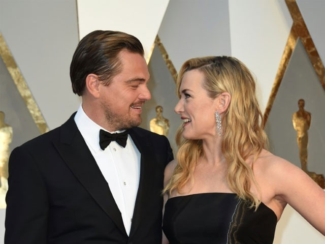 Leonardo DiCaprio and Kate Winslet pose with their