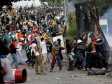 demonstrators-clash-with-riot-security-forces-at-the-fence-of-an-air-base-while-rallying-against-venezuelas-president-nicolas-maduro-in-caracas-2
