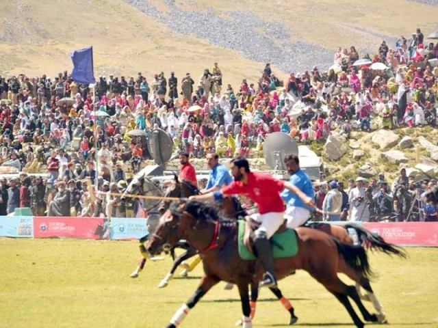 Players take part in a polo match at Shandur. PHOTO: EXPRESS