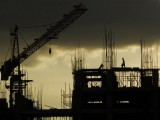 labourers-work-at-a-construction-site-as-monsoon-clouds-cover-the-sky-in-hyderabad-2