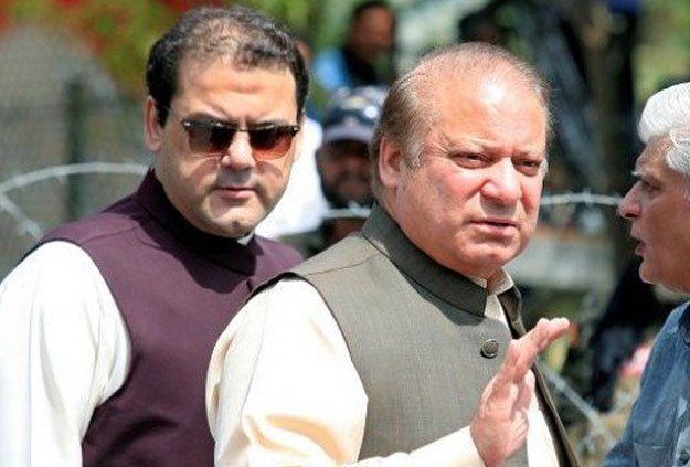 Hussain Nawaz with PM Nawaz Sharif. PHOTO: REUTERS