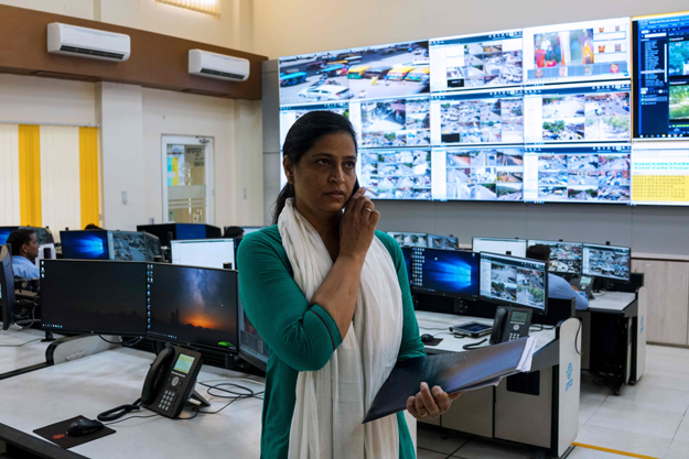 Kamal Shekhawat, head of the female police patrol unit, talks on the phone while standing inside the police command centre at the Jaipur Commissionate Headquarters in the Indian city of Jaipur. All-female police units are shaking up the male-dominated force in conservative northwest India, hitting the streets to combat sex crimes and a pervasive culture of silence around rape. PHOTO: AFP
