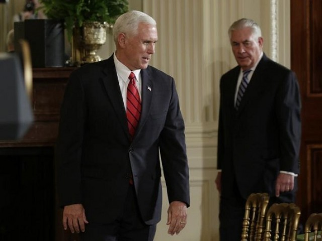 U.S. Vice President Mike Pence (L) arrives with Secretary of State Rex Tillerson (R) to attend a joint press conference held by U.S. President Donald Trump and Colombian President Juan Manuel Santos at the White House in Washington, U.S., May 18, 2017. PHOTO: REUTERS