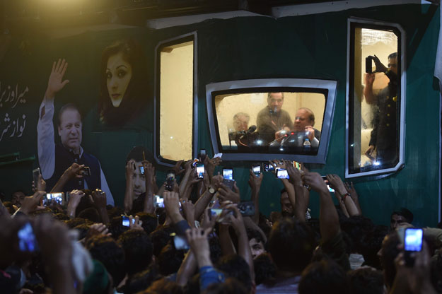 Ousted Pakistani prime minister Nawaz Sharif addresses a rally from his bullet-proof container in Rawalpindi on August 9, 2017. Deposed Pakistani prime minister Nawaz Sharif is leading a rally from the capital Islamabad to his home in Lahore, following his ouster by the Supreme Court following a corruption probe. PHOTO: AFP