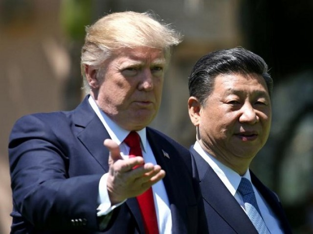 US President Donald Trump with China's President Xi Jinping. PHOTO: REUTERS
