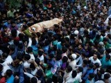 kashmiri-muslims-carry-the-body-of-burhan-wani-a-separatist-militant-leader-during-his-funeral-in-tral