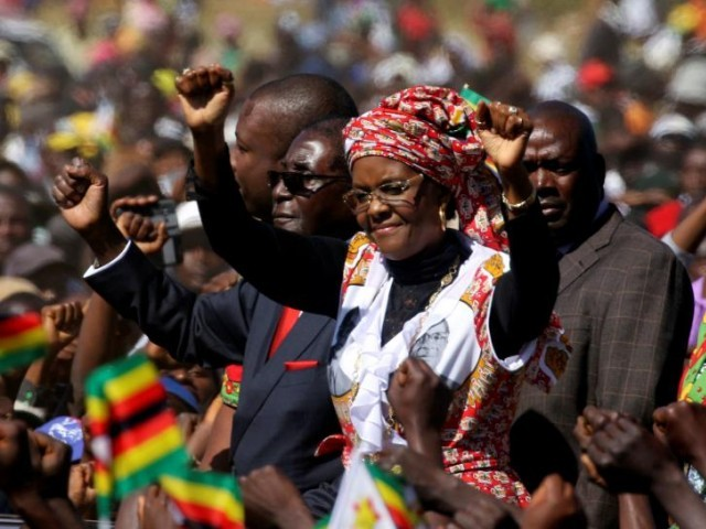 President Robert Mugabe and his wife Grace greet supporters of his ZANU (PF) party during a rally in Harare, Zimbabwe. PHOTO: REUTERS