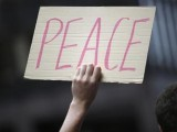 a-demonstrator-holds-a-peace-sign-during-an-anti-nuclear-weapons-protest-rally-and-march-in-new-york-2-2