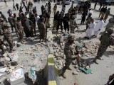 security-officials-gather-at-the-site-of-a-bomb-explosion-in-quetta