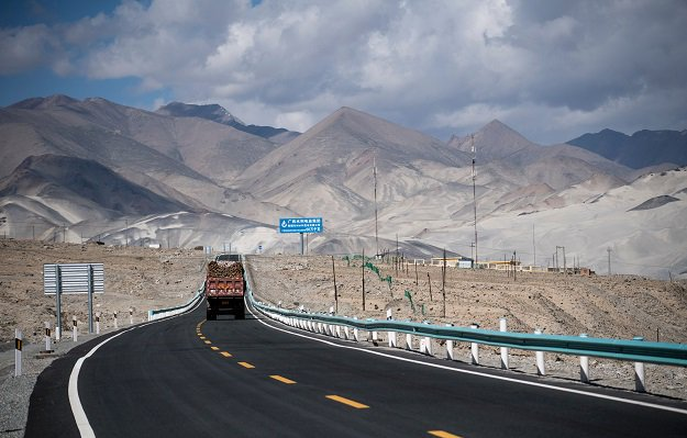 A truck drives along the China-Pakistan Friendship Highway before the Karakorum mountain range near Tashkurgan in China's western Xinjiang province. PHOTO: AFP