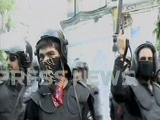 Police try to stop protesters advancing towards US Consulate in Karachi