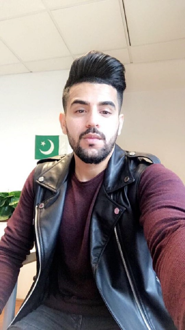 Arsalan posing with the Pakistani flag on Independence Day in the international relations office at his university in Istanbul.