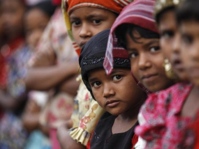 Rohingya Muslim children attend religious school at a refugee camp outside Sittwe, Myanmar. PHOTO: REUTERS