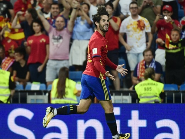 Spain's midfielder Isco celebrates his second goal during the World Cup 2018 qualifier football match between Spain and Italy at the Santiago Bernabeu stadium in Madrid on September 2, 2017.  PHOTO: AFP