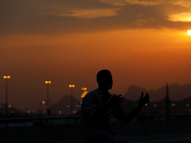 A pilgrim prays on the first day Hajj in Arafat, Saudi Arabia. PHOTO: REUTERS