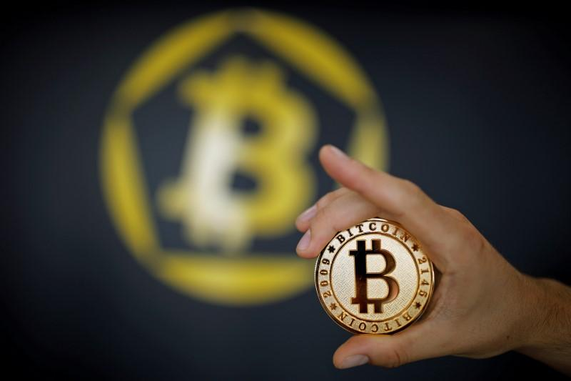 a-bitcoin-virtual-currency-coin-is-seen-in-an-illustration-picture-taken-at-la-maison-du-bitcoin-in-paris-5