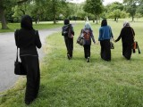 yasmin-hana-and-their-friends-walk-in-the-park-after-finishing-a-gcse-exam-near-their-school-in-hackney-east-london