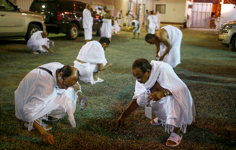 Pilgrims gather stones to be used to throw at marks symbolising Satan. PHOTO: REUTERS