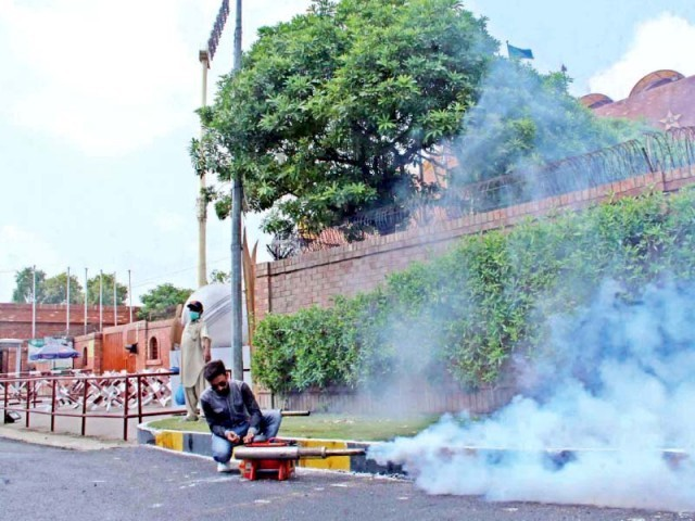Dengue spray is being carried out outside the Gaddafi Stadium. PHOTO: ABID NAWAZ: EXPRESS