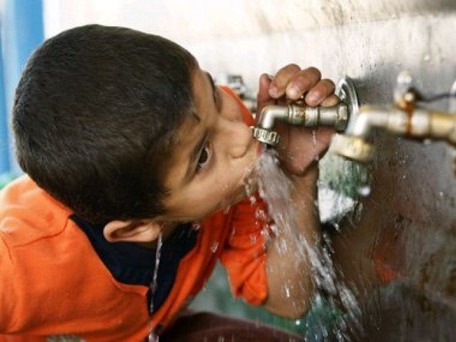 A child drinking water from the tap. PHOTO: REUTERS