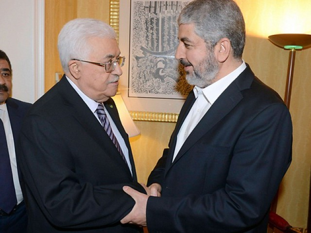 Fatah leader and PA President Abbas with Hamas leader Mashal in Doha. PHOTO: REUTERS