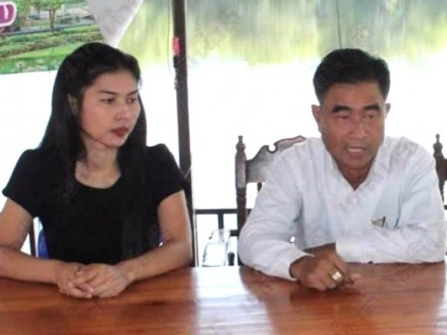 58-year-old Tambon Prasert with his newest wife, 27-year-old Nam Fon. PHOTO COURTESY: Buriram Times