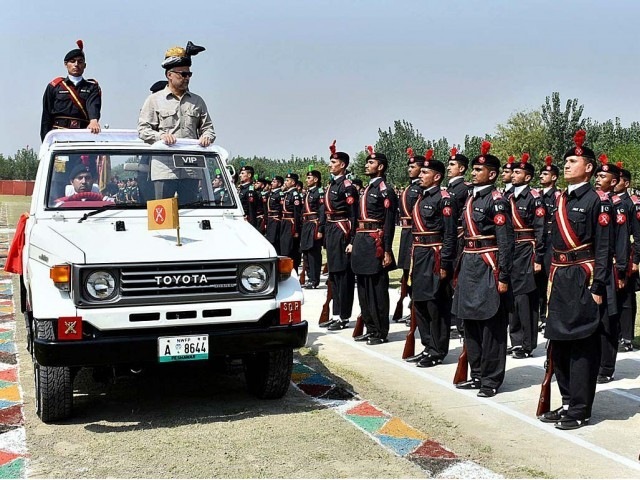 Ahsan Iqbal reviewing FC parade. PHOTO: APP