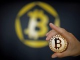 a-bitcoin-virtual-currency-coin-is-seen-in-an-illustration-picture-taken-at-la-maison-du-bitcoin-in-paris-5-2