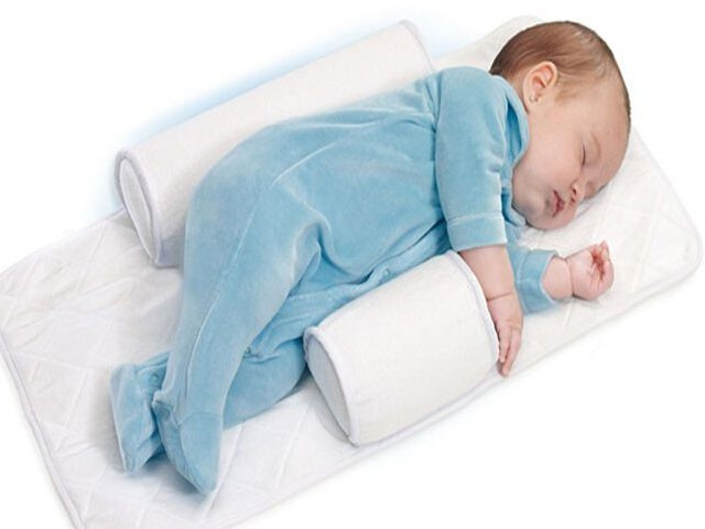 Baby sleep positioners pulled over death warning