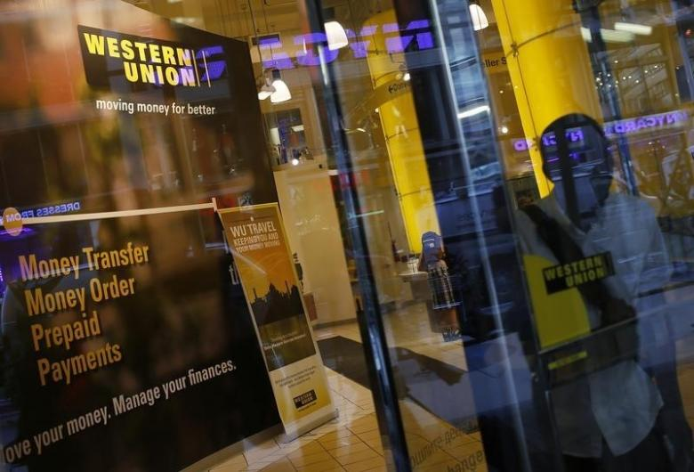 A person walks out of a Western Union branch in New York. PHOTO: REUTERS