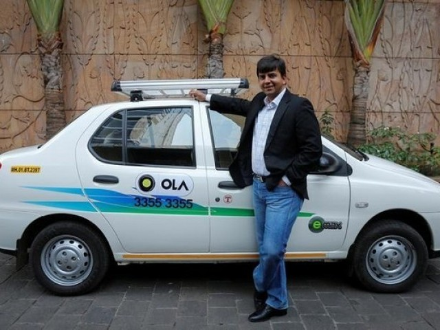 Bhavish Aggarwal, CEO and co-founder of Ola, an app-based cab service provider, poses in front of an Ola cab in Mumbai March 3, 2015. PHOTO: REUTERS