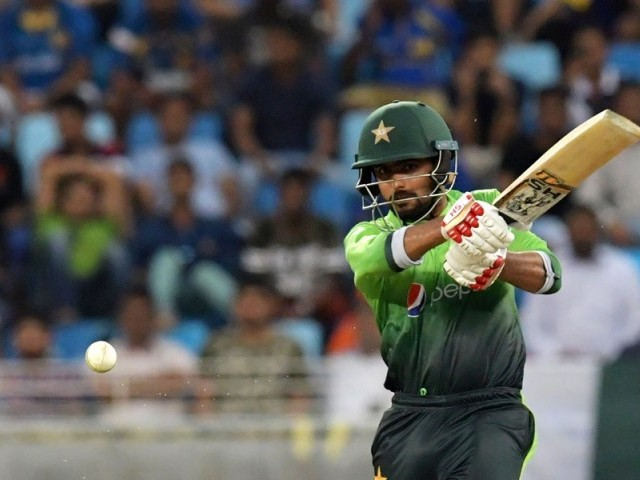 Pakistan's Babar Azam bats during the first one day international (ODI) cricket match between Sri Lanka and Pakistan at Dubai International Stadium in Dubai on October 13, 2017. PHOTO: AFP
